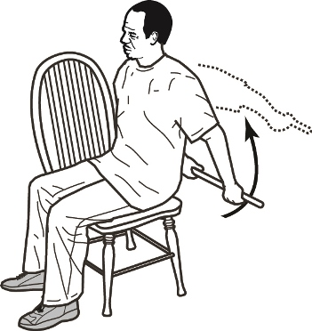 Man sitting on chair holding cane behind back